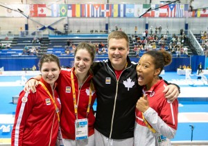 Leonora MacKinnon (2nd from left) and David Howes at the Pan-Am Games. photo credit - Devin Manky Photography